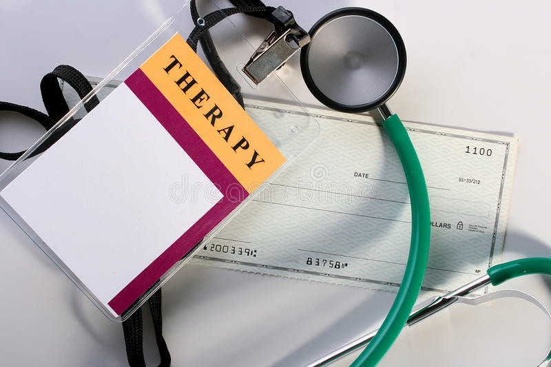 Paid medicine. Theme of paid medicine, ID Card, a stethoscope and a banker's check stock photography