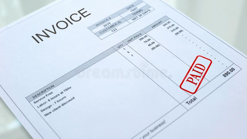 Paid seal stamped on invoice document, business bills, accountancy expense. Stock photo royalty free stock photography