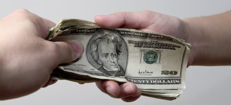 Paiement de l'argent photographie stock