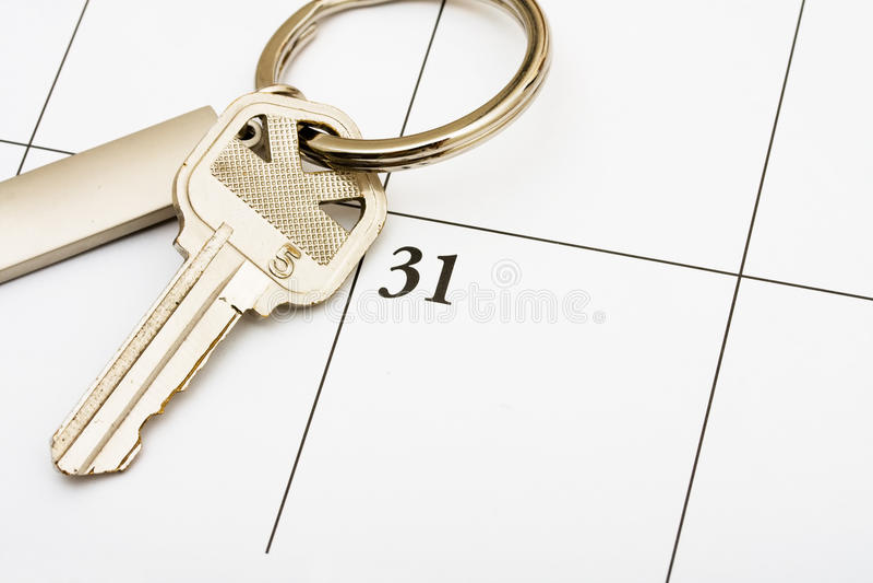 Paiement de votre hypothèque à l'heure photographie stock