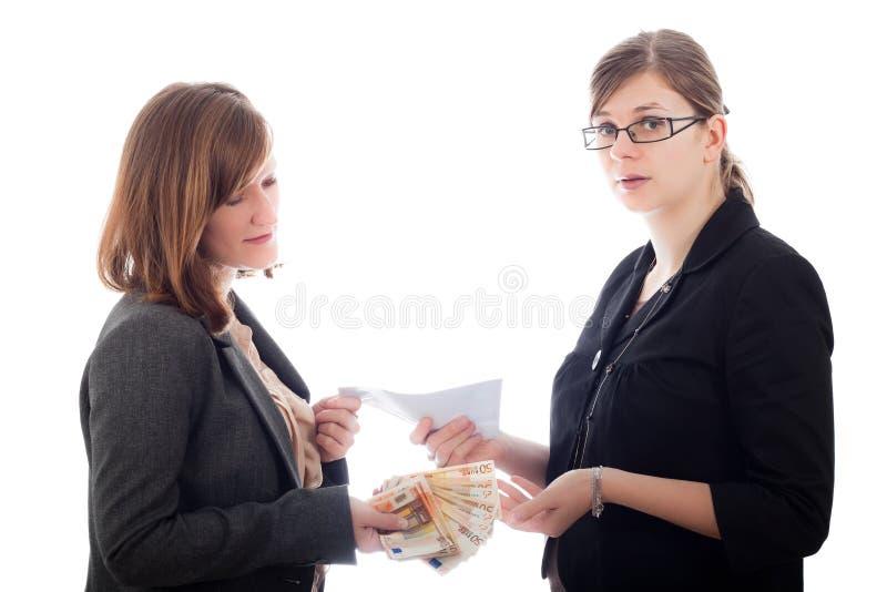 Paiement illicite altéré de femmes d'affaires photo stock