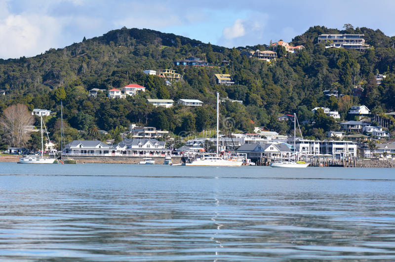 Paihia - Bay of Islands New Zealand. PAHIA, NZ - MAY 11 2014:General view of the main tourist town in northland, Pahia, as view from at sail boat on the water at royalty free stock photo