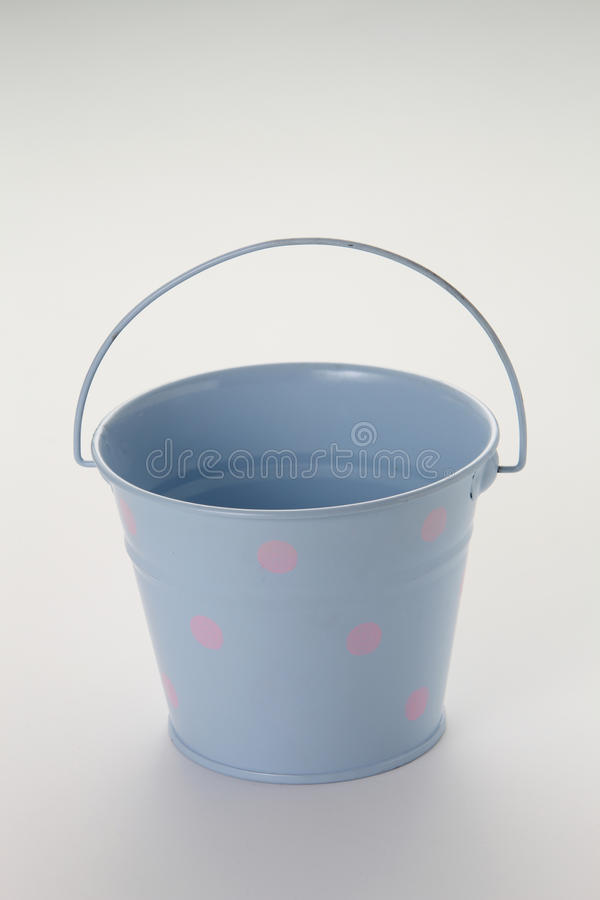 Pail. Blue color pail on the white background royalty free stock image