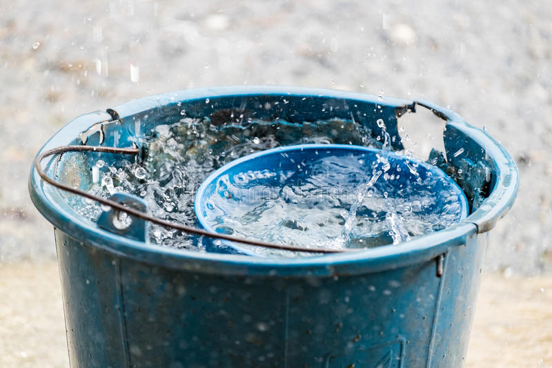 Pail water dipper blue old rain water. Reserve royalty free stock photo