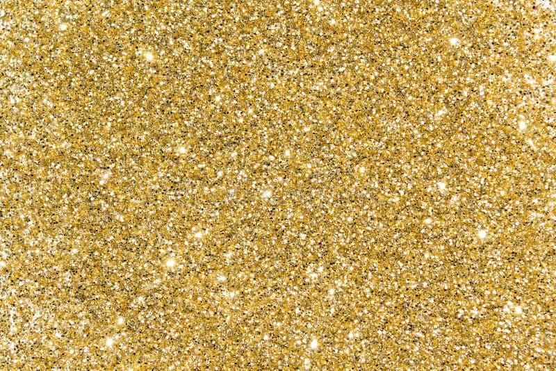 Paillettes d'or Éclat lumineux Poudre jaune scintillement Briller de retour photos libres de droits