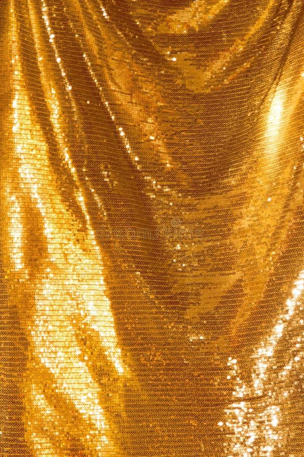 Paillettes d'or - textile pailleté de scintillement images stock