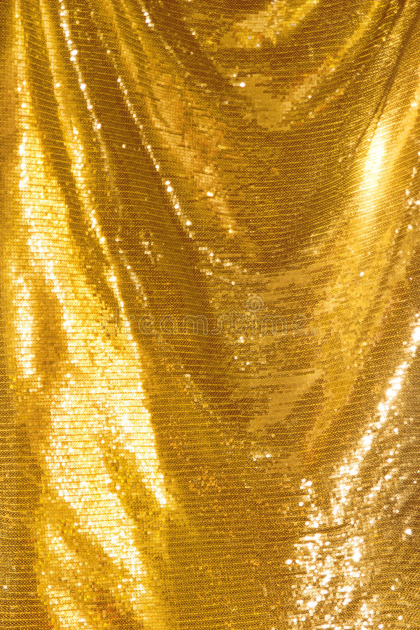 Paillettes d'or - textile pailleté de scintillement photo stock