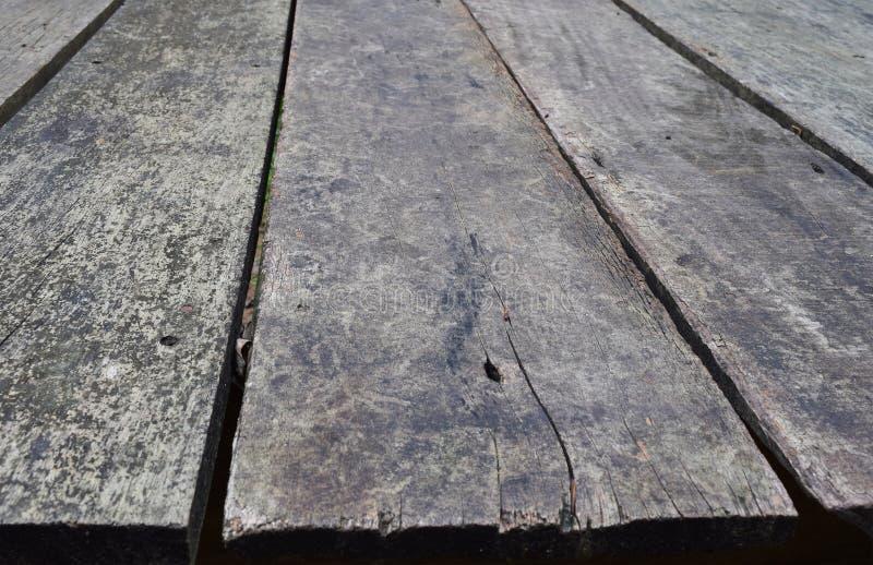 Painéis de madeira da textura da parede do grunge velho usados como o fundo foto de stock