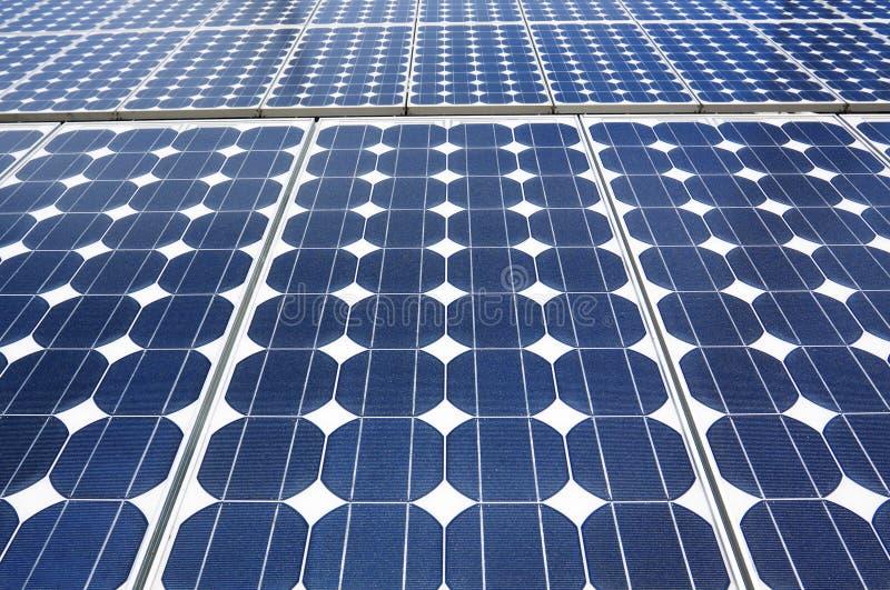 Painéis solares azuis fotografia de stock royalty free