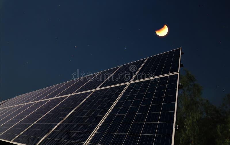 Painéis solares com a meia lua imagem de stock royalty free