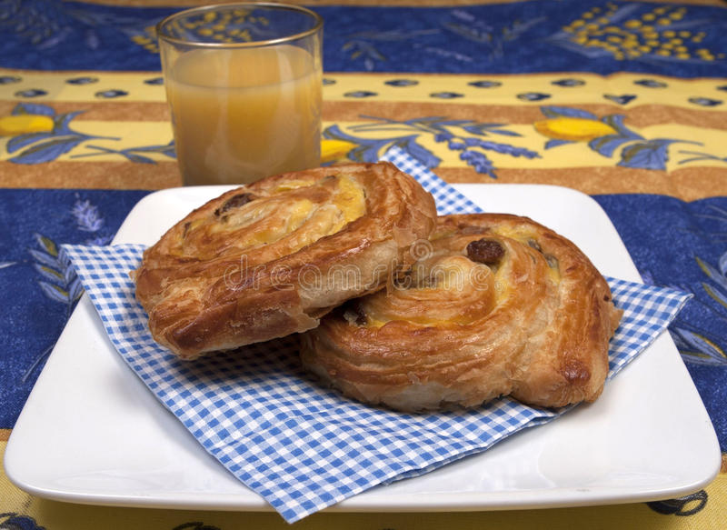 Pain aux raisin. A French breakfast of pain aux raisin royalty free stock photography