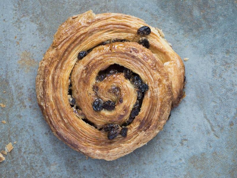 Pain aux raisins. A French spiral pastry pain aux raisins royalty free stock image
