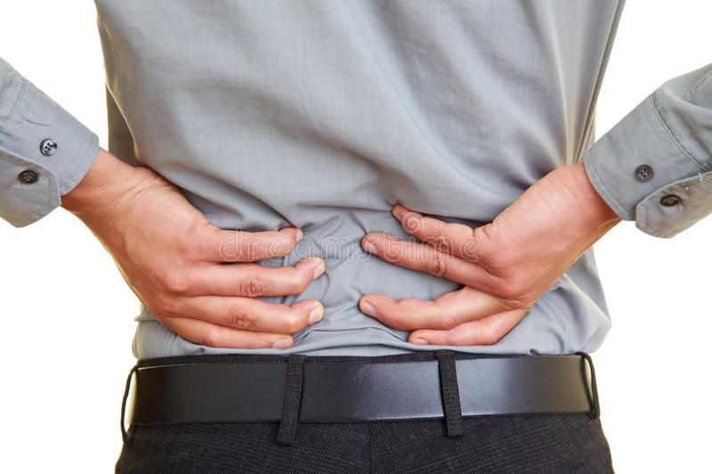 Pain in the back. Man standing with pain in his back royalty free stock photos