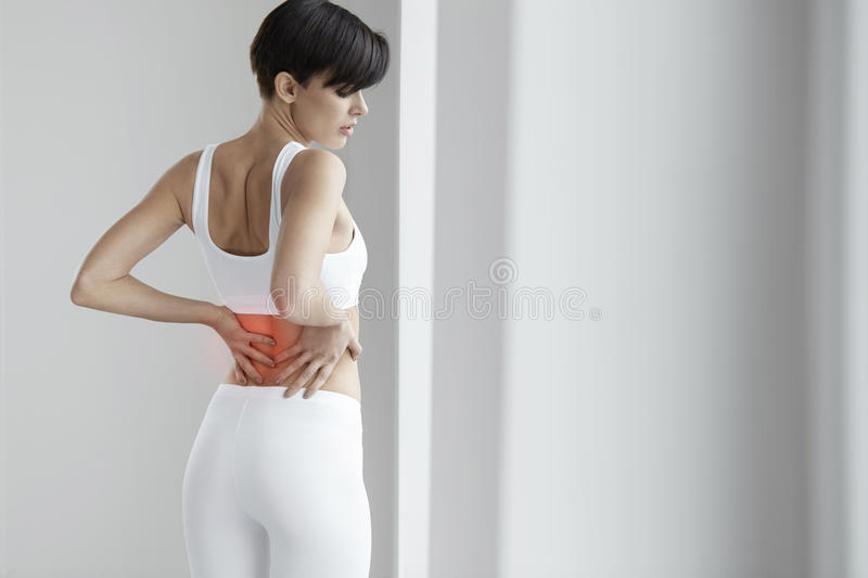 Pain. Beautiful Female Having Painful Feeling In Back, Backache royalty free stock images