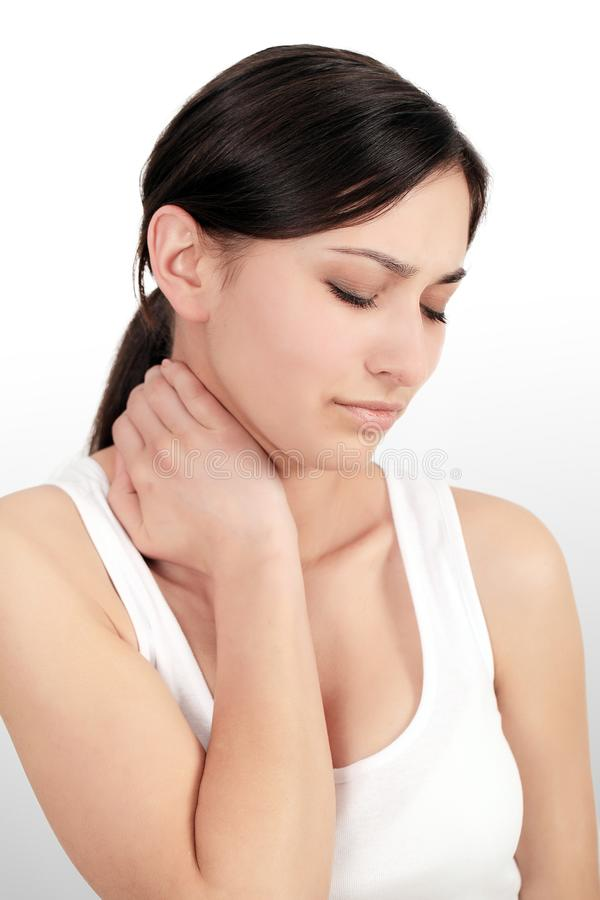 Pain In Body. Portrait Of Beautiful Young Woman Feeling Pain In Neck And Shoulders. Attractive Tired Exhausted Having Body Aches A royalty free stock photos
