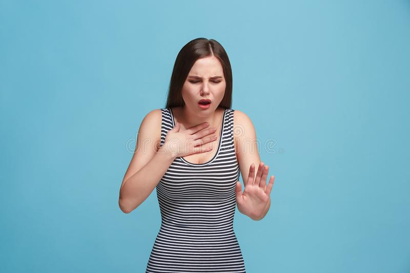 Young woman overwhelmed with a pain in the throat stock photo