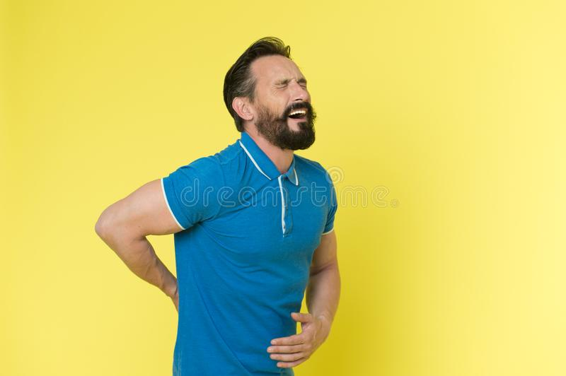 Pain concept. Senior man feel pain in back. Bearded man suffer from pain. I know real pain, copy space stock photography