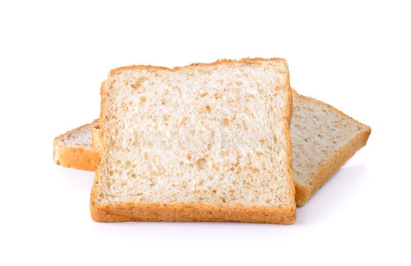 Pain de blé entier d'isolement sur le fond blanc image libre de droits