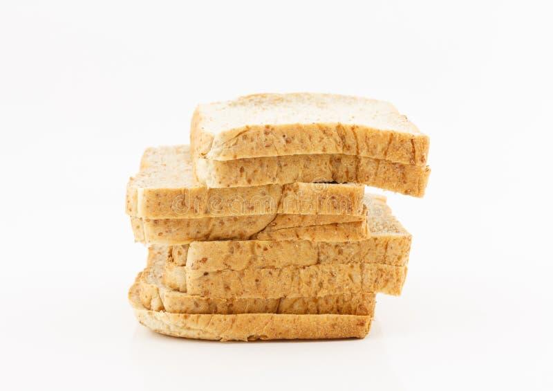 Pain de blé entier sur le fond blanc images libres de droits