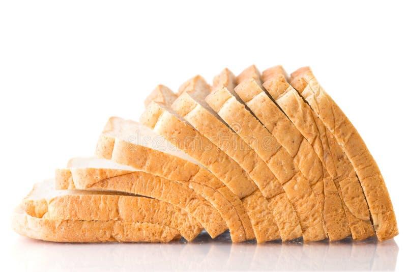 Pain de blé entier sur un fond blanc photo libre de droits