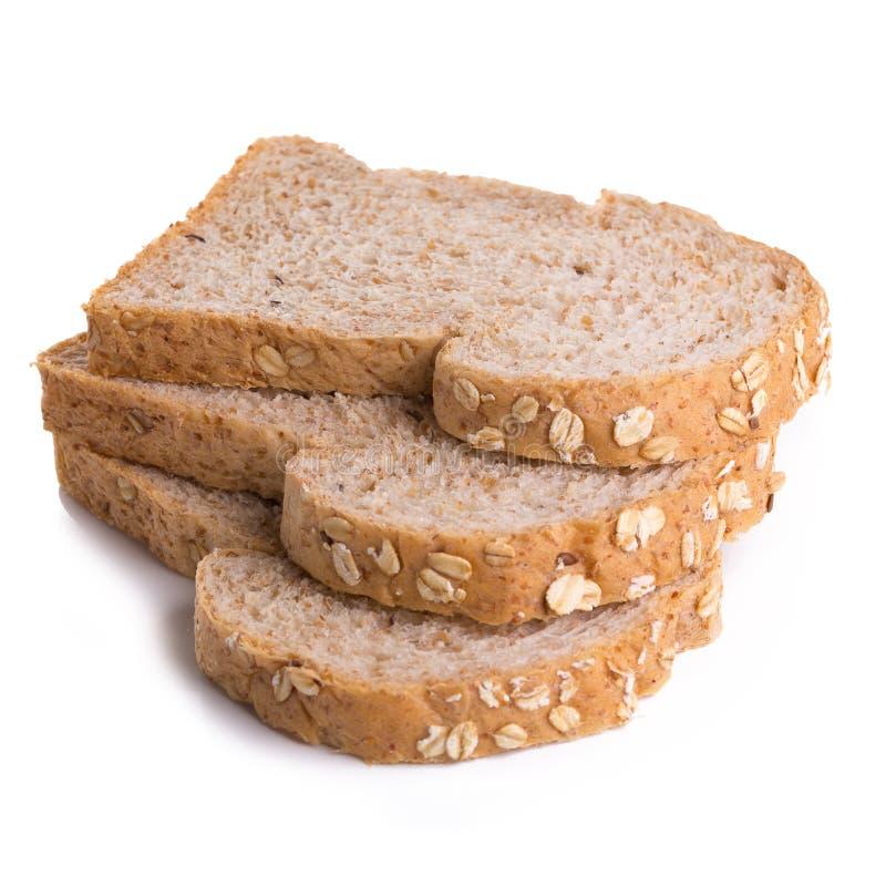 Pain de pain de blé entier d'isolement sur le fond blanc images stock