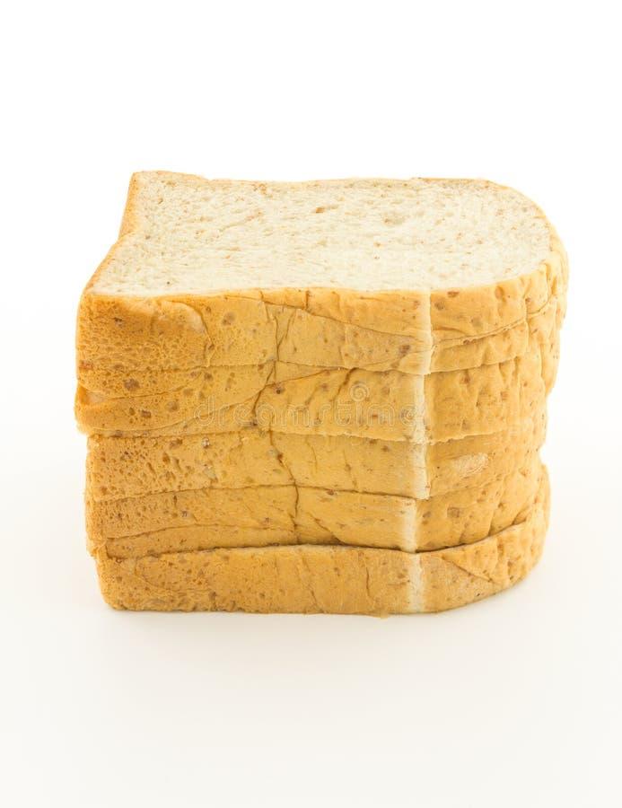 Pain de pain de blé entier sur le fond blanc photo stock