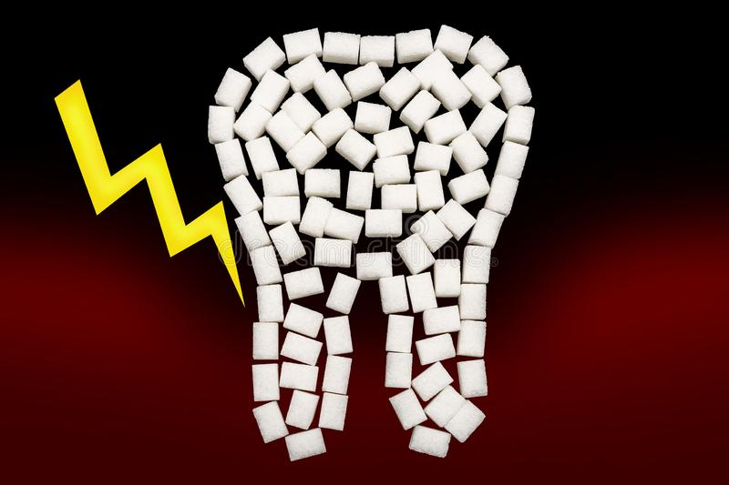 Pain due to episodes of periodontitis presented with lumb sugar. White sugar cubes in the form of a tooth in front of a dark background with a lightning royalty free stock photography