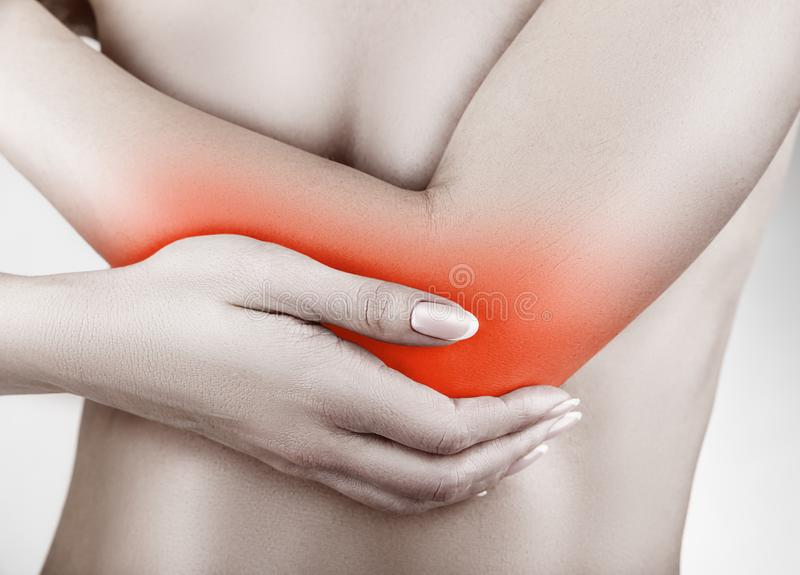 Pain in elbow stock image