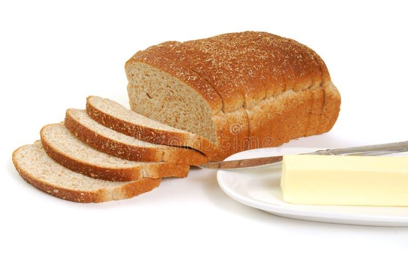 Pain et beurre de blé entier photographie stock
