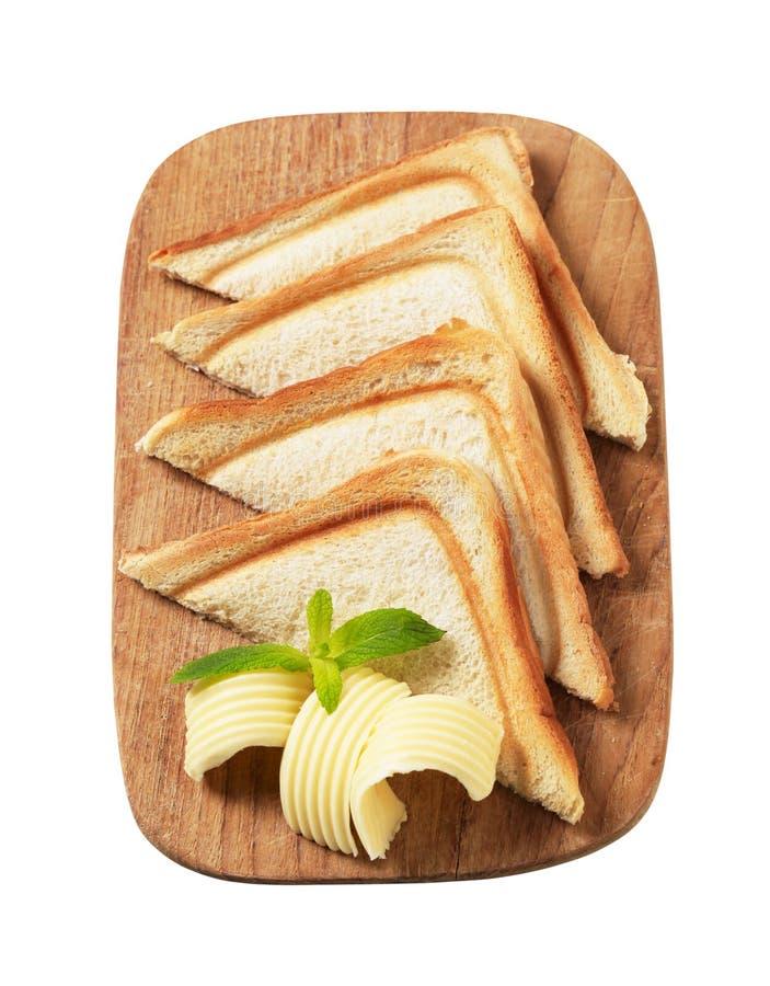 Pain et beurre grillés images stock