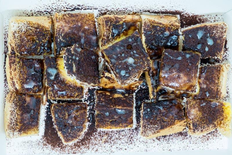 Pain grillé d'Ovaltine avec du beurre et le lait condensé adouci photographie stock