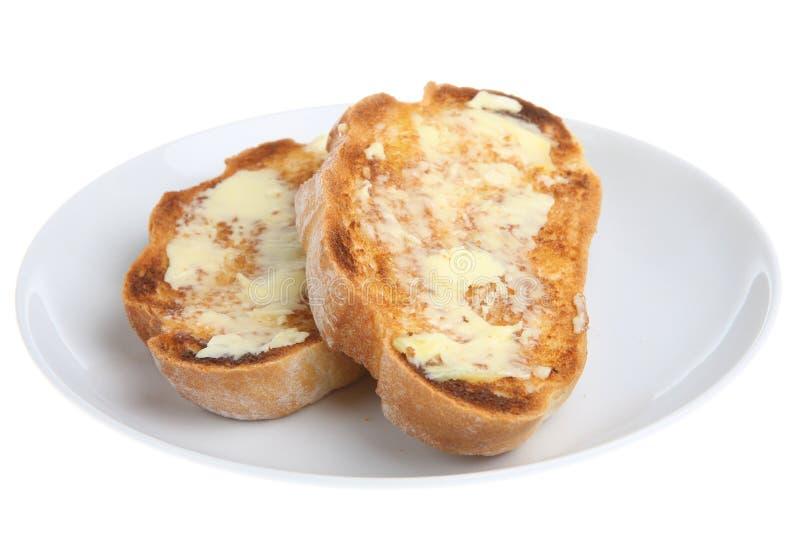 Pain grillé et beurre photographie stock libre de droits