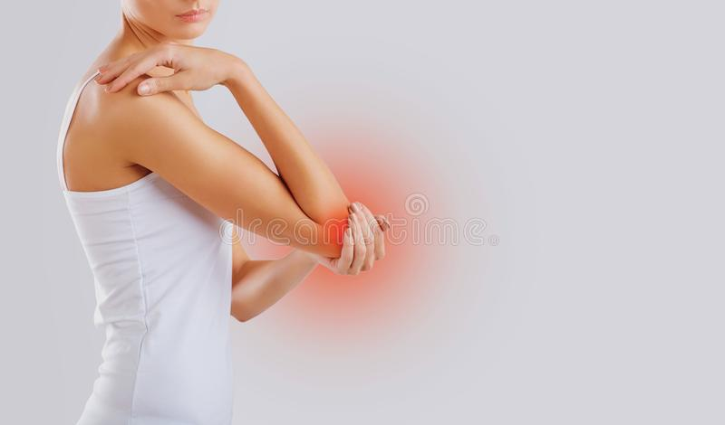 Pain, injury in the elbow joint. stock image