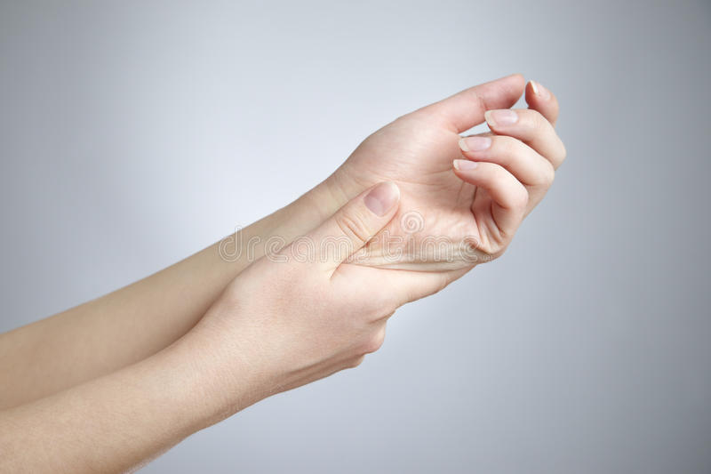 Pain in the joints of the hands. Care of female hands royalty free stock photos