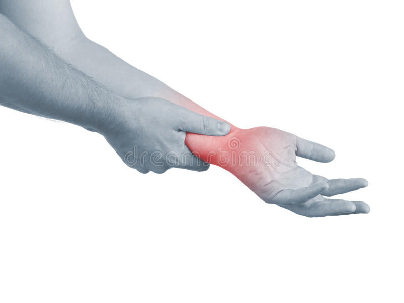 Pain in a man wrist. Male holding hand to spot of wrist pain stock photography