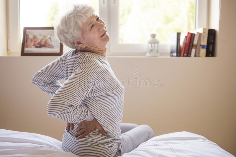 Pain in my back royalty free stock photography