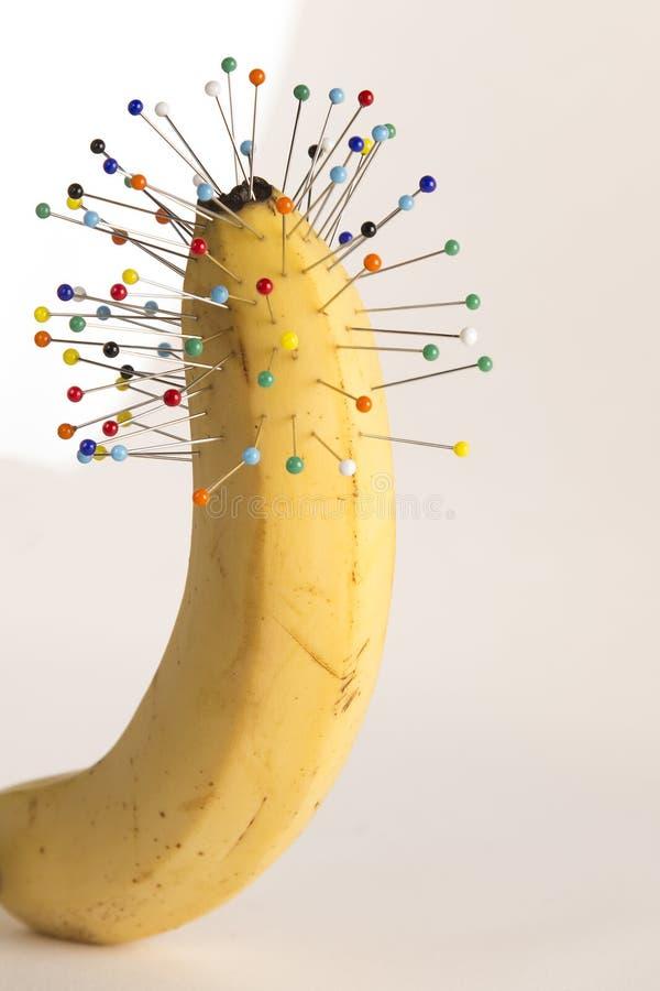 pain: pins and banana royalty free stock images