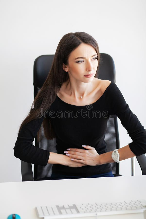 Pain. Pregnant Business Woman Working at Office Motherhood Sitting Tired royalty free stock photos