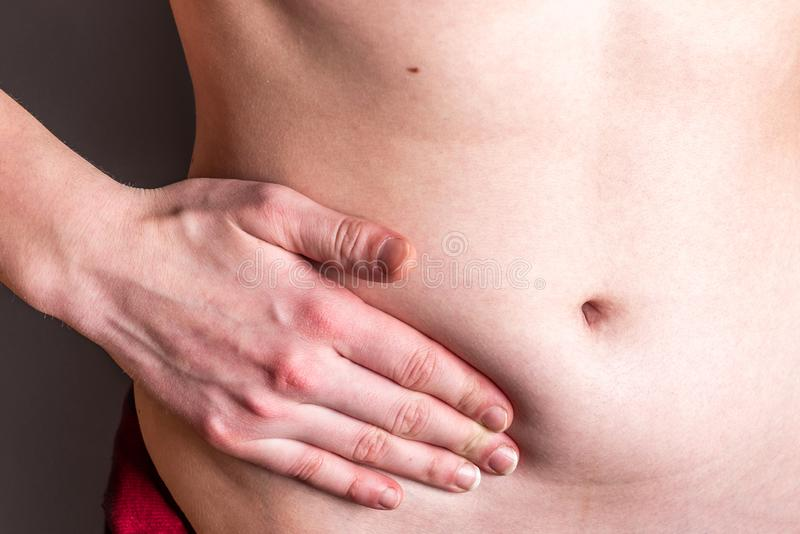 Pain in the right side. Attack of appendicitis. stock image