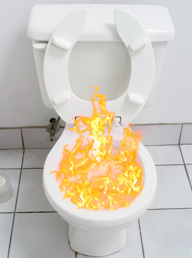 Pain and suffering of hemorrhoids. A flaming toilet representing the fear of pain and suffering due to bowel diseases or hemorrhoids stock image