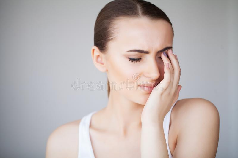 Pain Tired Exhausted Stressed Woman Suffering From Strong Eye Pain. Portrait Of A Beautiful Young Woman Feeling Sick royalty free stock photography