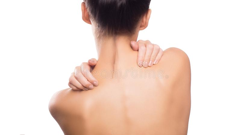 Pain. Woman touchig her neck. Massaging neck. Isolated on white. stock photos