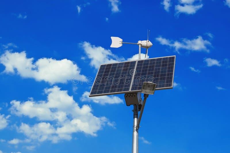 Painel solar e moinho de vento foto de stock royalty free