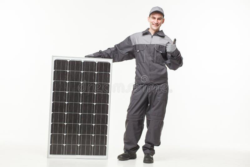 Painel solar isolado no construtor branco do fundo imagem de stock
