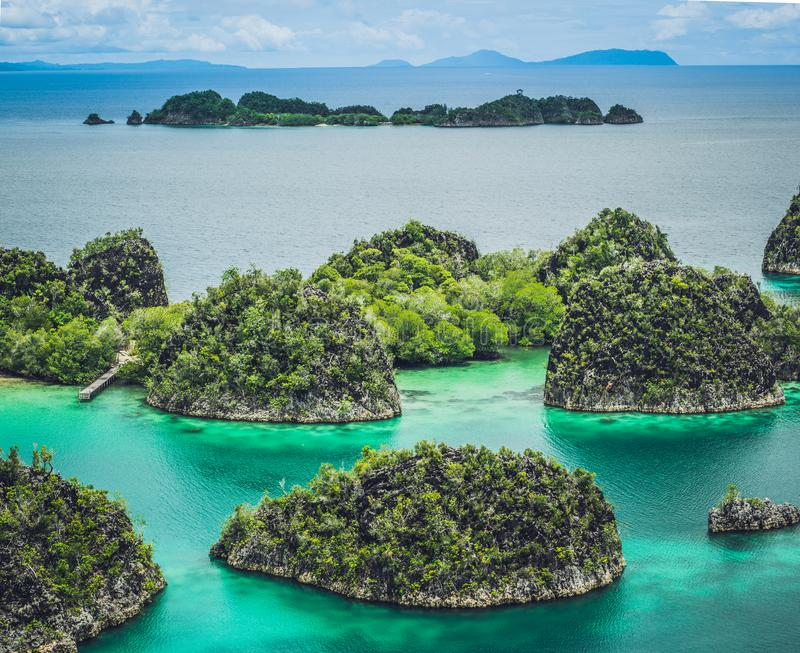 Painemo, Group of small island in shallow blue lagoon water, Raja Ampat, West Papua, Indonesia royalty free stock images