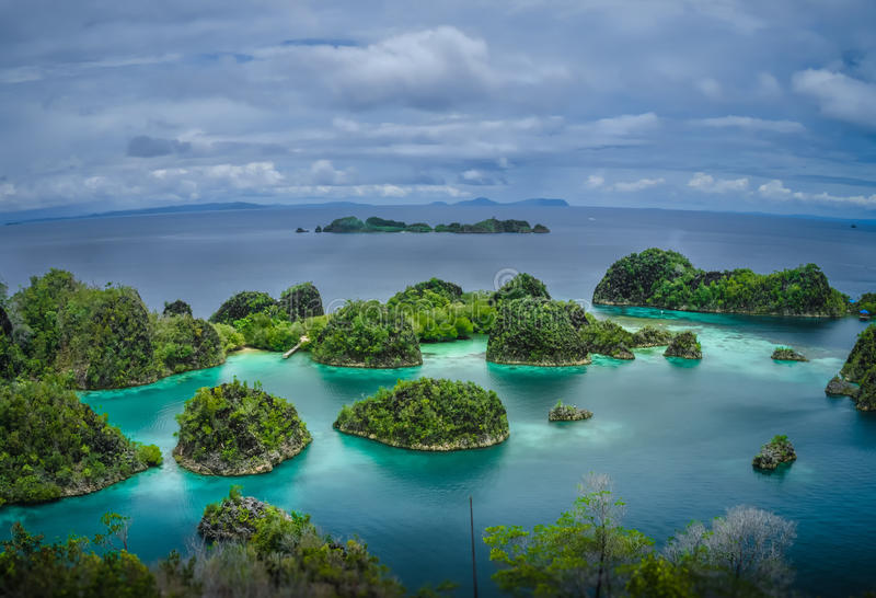 Painemo Islands, Blue Lagoon with Green Rockes, Raja Ampat, West Papua, Indonesia royalty free stock photos