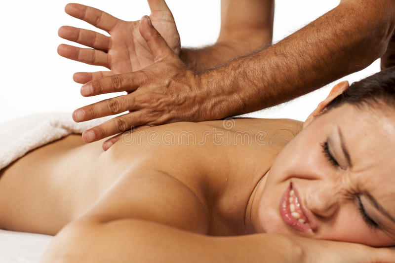 Painful back massage royalty free stock photo