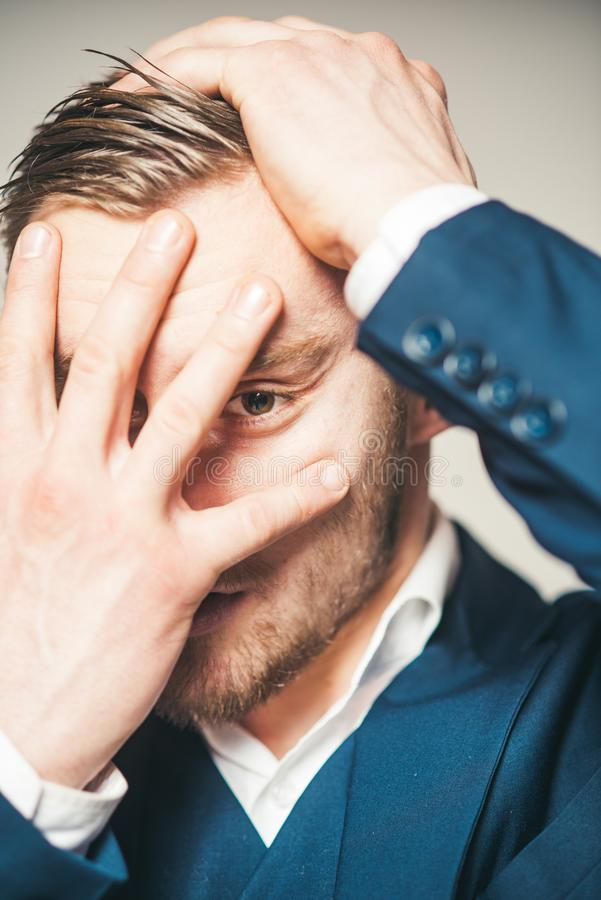 Painful memories. Guy hiding out of reality. Man serious unhappy hiding face while remembering bad embarrassed events royalty free stock photo