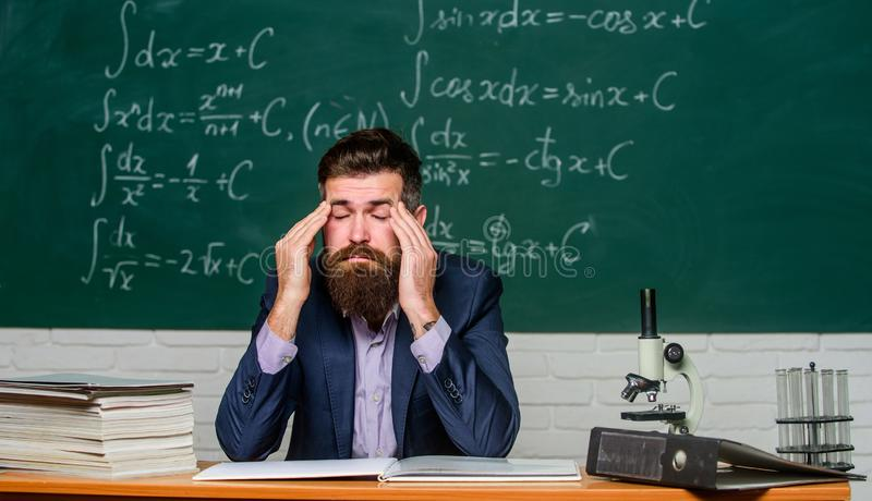 Painkiller needed. School teacher have pain in head. Bearded man suffer from pain at lesson. Complain of pain in head. Headache or migraine. Aching pain stock photos