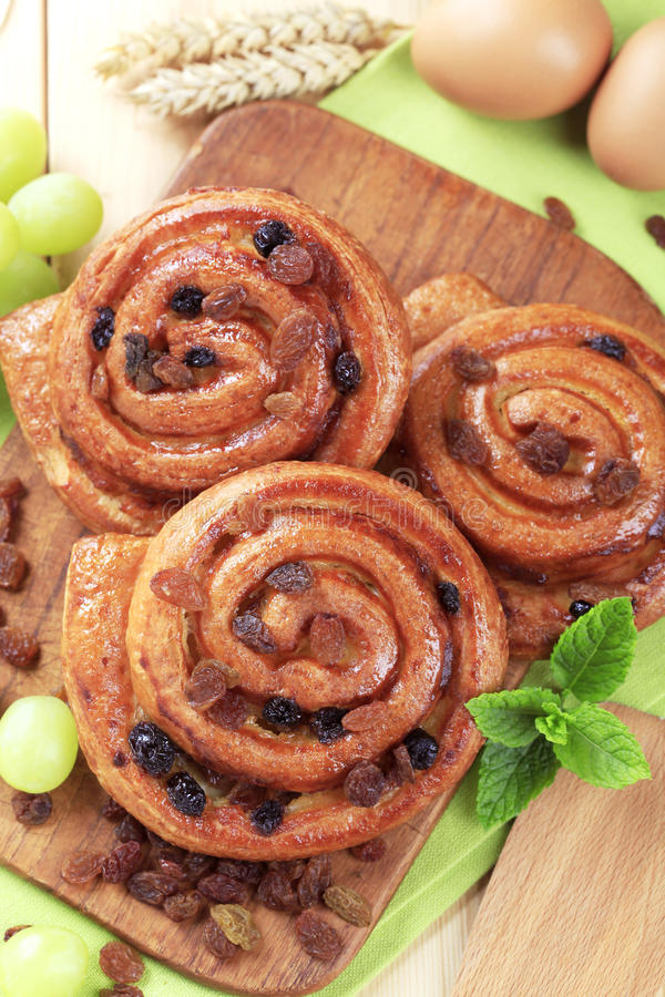 Pains aux raisins. Puff pastry swirls with raisins royalty free stock photography